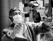 A black and white photo of a surgeon doing cataract surgery