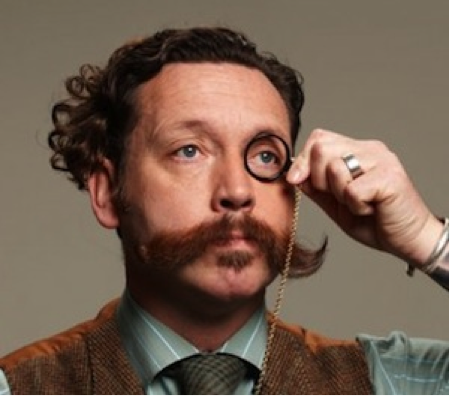 man wearing monocle